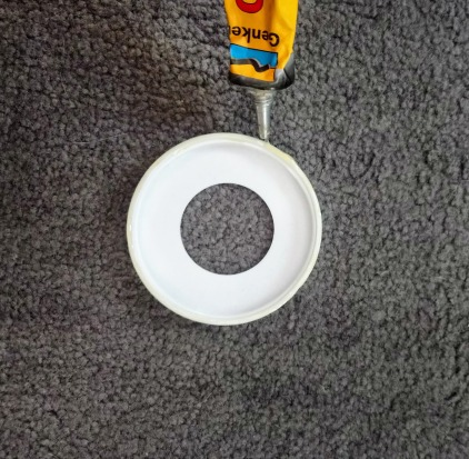 If you don't have contact cement and firm hold glue should work fine too! Just make sure it is suitable for plastic.