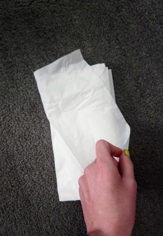 Fold it diagonally across the pile